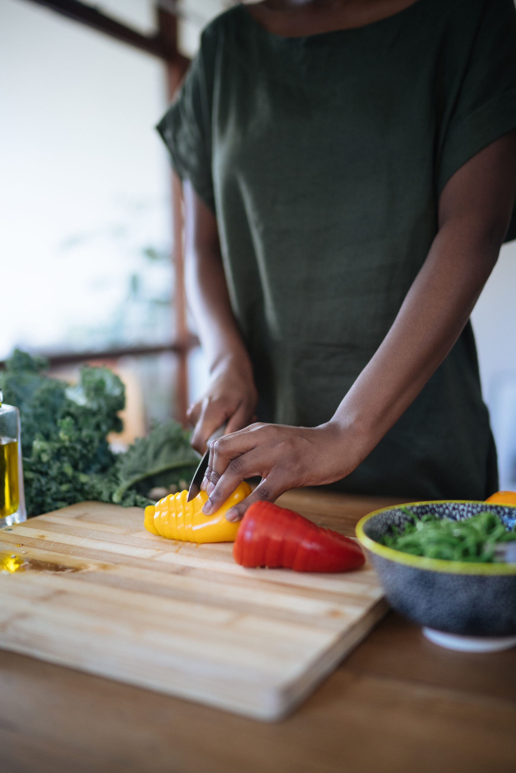 photo-of-person-cutting-bell-peppers-3621212